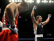 Bekzod Khidirov, left, of Uzbekistan, hangs his head as Onur Sipal, of Turkey, celebrates after their round of 16 bout in the Lightweight 60kg class of the World Boxing Championships in Chicago, Wednesday, Oct. 31, 2007. Sipal advanced in the Championships with a 28-25 win.  (AP)