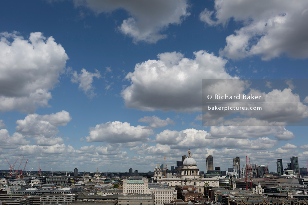 London skyline including St. Paul's Cathedral, seen from the top floor viewing terrace of Tate Modern on the Southbank, on 14th May 2017, in London, England.