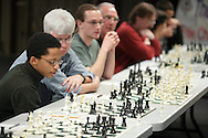 Middletown, NY - Some of the 32 players battling chess champion Deepak Aaron look at their boards during an exhibition at Middletown High School on Saturday, Jan. 30, 2010.