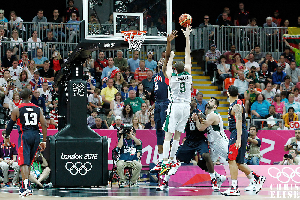 04 August 2012: Lithuania Darius Songaila goes for the skyhook over USA Kevin Durant during 99-94 Team USA victory over Team Lithuania, during the men's basketball preliminary, at the Basketball Arena, in London, Great Britain.