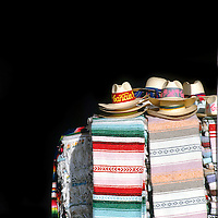 Stacked of Mexican sombrero / hats, offered as souvenirs in Cancun, Mexico. Mexico stock photos.