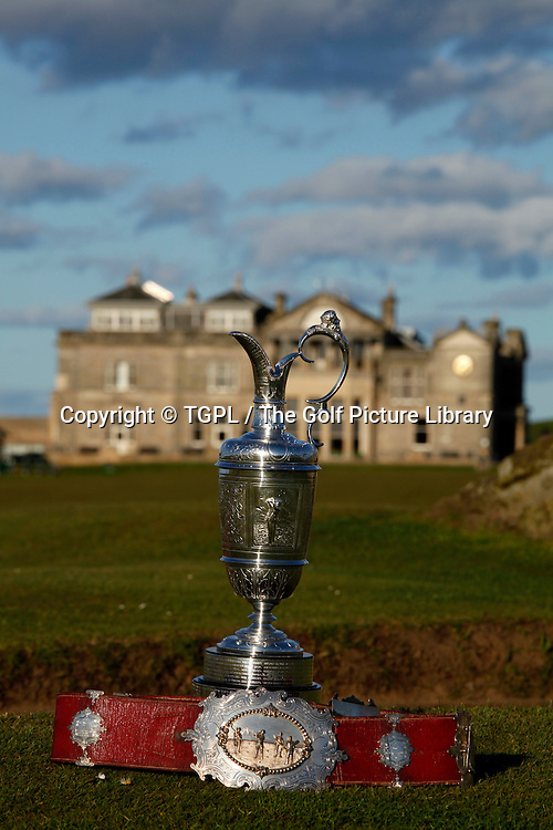 The famous Claret Jug trophy played for each summer for The Open Championship over a rota of links courses across Great Britain and Ireland during sring at St Andrews Old Course,<br /> St Andrews,Fife,Scotland.Also shown is the Champions Belt,that the championship winner used to get before the trophy was introduced.
