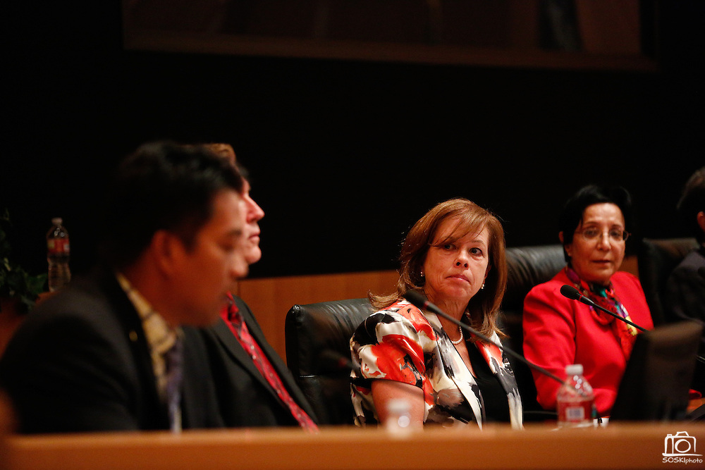 Marsha Grilli listens to her competition during the Milpitas City Council Forum at Milpitas City Hall in Milpitas, California, on October 9, 2014. (Stan Olszewski/SOSKIphoto)