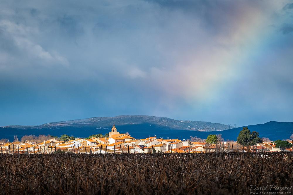 Canohes village under a rainbow.