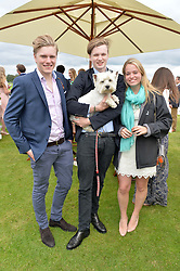 Left to right, JAMIE BARKER, HUGO BAMBERGER and MARINA VERE NICOLL with Lincoln the dog at the Cartier Queen's Cup Final polo held at Guards Polo Club, Smith's Lawn, Windsor Great Park, Egham, Surrey on 15th June 2014.