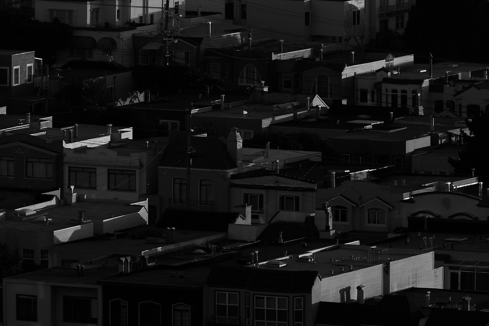 Houses lining the Sunset District are seen at midday from Grandview Park in San Francisco, California.
