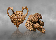 Hittite terra cotta two handled vessel and a ritual vessel in the shape of a bunch of grapes - 16th century BC - Hattusa ( Bogazkoy ) - Museum of Anatolian Civilisations, Ankara, Turkey . Against grey art background .<br /> <br /> If you prefer to buy from our ALAMY STOCK LIBRARY page at https://www.alamy.com/portfolio/paul-williams-funkystock/hittite-art-antiquities.html  - Type Hattusa into the LOWER SEARCH WITHIN GALLERY box. Refine search by adding background colour, place, museum etc<br /> <br /> Visit our HITTITE PHOTO COLLECTIONS for more photos to download or buy as wall art prints https://funkystock.photoshelter.com/gallery-collection/The-Hittites-Art-Artefacts-Antiquities-Historic-Sites-Pictures-Images-of/C0000NUBSMhSc3Oo