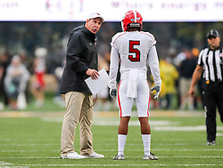 Sep 8, 2018; Morgantown, WV, USA; Youngstown State Penguins head coach Bo Pelini talks with Youngstown State Penguins cornerback William Latham (5) during the first quarter against the West Virginia Mountaineers at Mountaineer Field at Milan Puskar Stadium. Mandatory Credit: Ben Queen-USA TODAY Sports