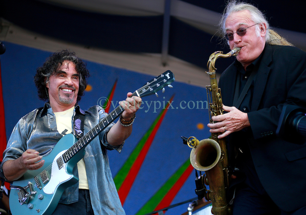 05 May 2013. New Orleans, Louisiana,  USA. .New Orleans Jazz and Heritage Festival. JazzFest..John Oates of music duo legends Daryl Hall and John Oates plays the Gentilly Stage with sax player Charles DeChant..Photo; Charlie Varley.