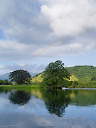 A morning rainbow over the Daintree River at Daintree Village, Queensland, Australia.