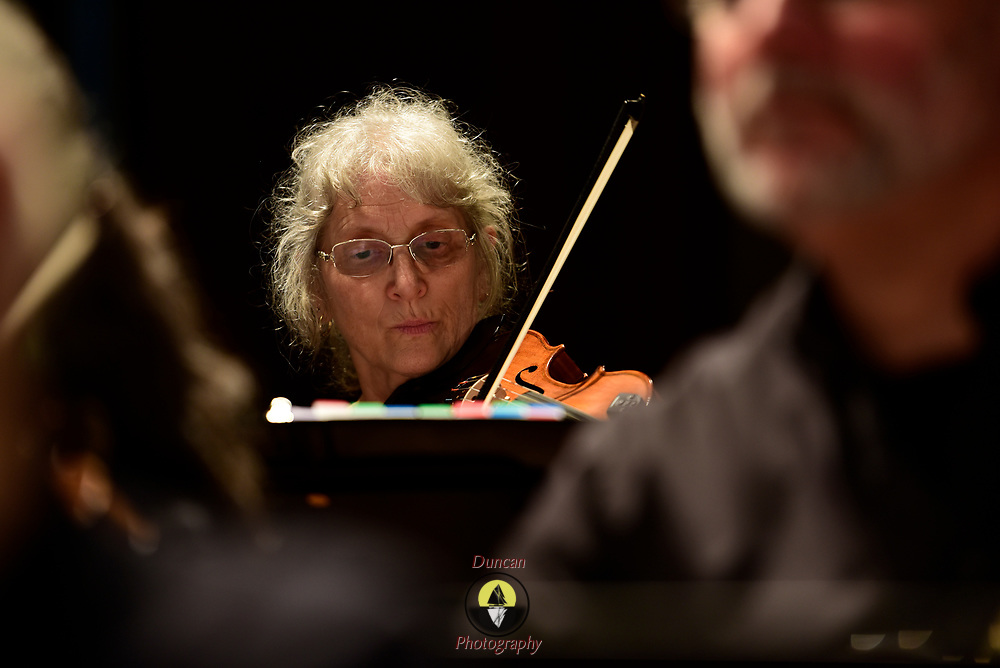 Description/Caption:<br /> Lewiston, MAINE -- OCTOBER 28, 2018 - Fiddleicious, Maine's largest fiddle orchestra, plays the Gendron Franco Center in Lewiston as the last concert of their season. <br /> Photo by Roger S. Duncan. Images permitted to be used for professional purposes by Fiddleicious. Personal use imagery is for sale at http://www.rogerduncanphoto.com .