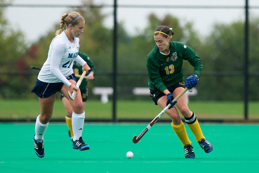 Catamounts midfielder Alana Izzo (13) in action during the women's field hockey game between the Maine Black Bears and the Vermont Catamounts at Moulton/Winder Field on Saturday afternoon September 29, 2012 in Burlington, Vermont.