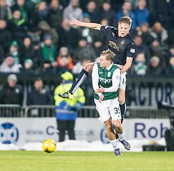 Falkirk's Peter Grant over Hibernian's Jason Cummings. <br /> Falkirk 1 v 1 Hibernian, Scottish Championship game played 17/1/2015 at The Falkirk Stadium.