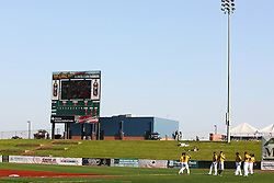 18 May 2012:  Cornbelter players warm up in right field between the bull pen and the scoreboard during a Frontier League Baseball game between the Windy City Thunderbolts and the Normal CornBelters at Corn Crib Stadium on the campus of Heartland Community College in Normal Illinois