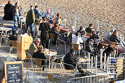 © Licensed to London News Pictures. 04/11/2020. Brighton, UK. Crowds gather on Brighton seafront ahead of a second national lockdown which starts tonight, in order to fight the spread of COVID-19. Photo credit: Liz Pearce/LNP