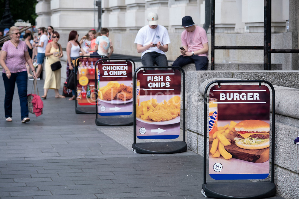 With many people and families staying in the UK for their Summer break during the school holidays, a large number of domestic tourists, who may normally have been travelling abroad, have decended on the capital to see the sights, as seen here on the South Bank where fast food is on sale on 11th August 2021 in London, United Kingdom. Following the Coronavirus / Covid-19 health scare of the last two years, and with some travel restrictions still in place, more people have chosen a staycation which is a holiday spent in ones home country rather than abroad, or one spent at home and involving day trips to local attractions.
