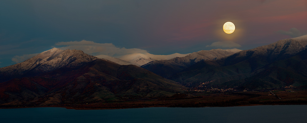 The October supermoon over the mountains at lake Prespa