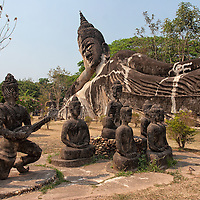 """""""Xieng Khouan"""" best known as Buddha Park is located 25km near Vientiane and <br /> worth a visit alone to admire some of the bizarrely shaped sculptures. The park includes a collection of over 200 Buddhist and Hindu statues of all models and sizes. On the photo you can see a reclining Buddha statue which is 120 m long."""