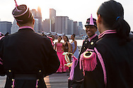 New York. Brooklyn. south american wedding with traditional dress, Brooklyn Pier. Fulton ferry pier under the bridge . manhattan skyline on east river  New York, Manhattan - United states  /  Mariage sud americain en costume traditionel, Brooklyn Pier sous le pont  de Brooklyn ; Le skyline de manhattan sur l east river  Manhattan, New York - Etats unis