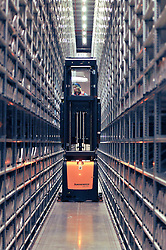 © London News Pictures. 2011/01/14 .A worker uses a forklift truck to stack books on shelves. The Bodleian Book Storage Facility (BSF) in Swindon, UK,  'ingests' its one millionth item, the book 'Journal of General Physiology Volume 1 1918-1919' on Friday, 14 January 2011. It has been achieved in just under three months and has required an average daily ingest rate of 19,000 books and periodicals per day by 32 staff. On peak days, and depending on the materials, as many as 42,000 items have been ingested. . Picture credit should read Stephen Simpson/LNP