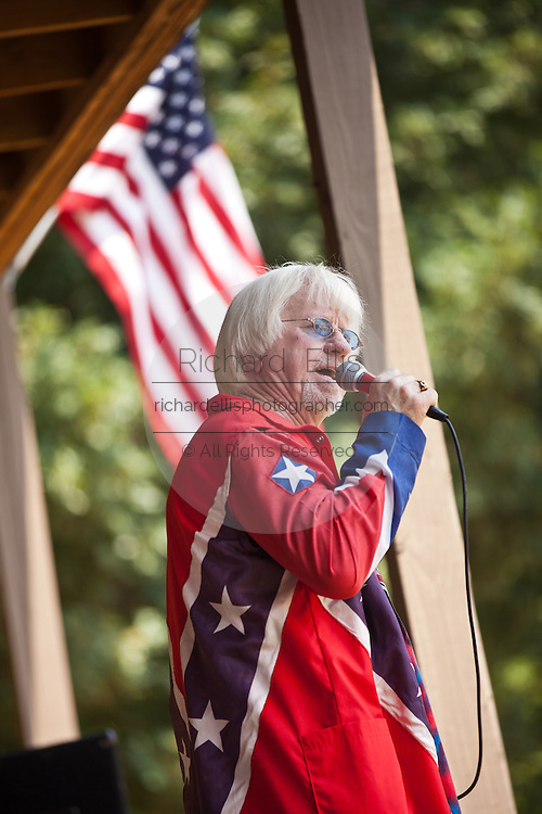 Singer wearing a confederate flag jacket during the annual Summer Redneck Games Dublin, GA.