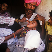 A child is immunized in the village of khuri in the Thar Desert near the border with Pakistan. Jaisalmer district, Rajasthan.