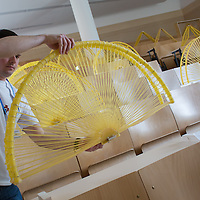 Competitor prepares his construction for the Spaghetti Bridge World Championship in Budapest, Hungary on May 24, 2013. ATTILA VOLGYI