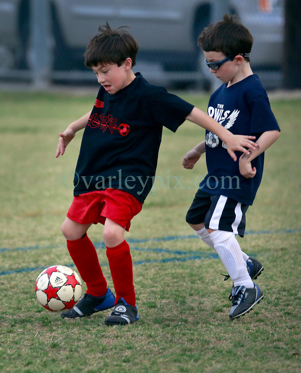 22 March 2013. New Orleans, Louisiana,  USA. .Carrolton Boosters Soccer. Under 8's. Owls go up against the Lasers, winning by a tight 3 -1..Photo; Charlie Varley.