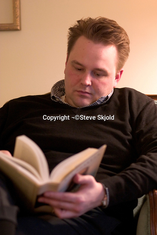 Man age 36 absorbed reading a good book.  Plymouth Minnesota USA