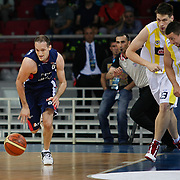 Fenerbahce Ulker's Roko Leni UKIC (R), Gasper VIDMAR (C) and Efes Pilsen's Igor RAKOCEVIC (L) during their Turkish Basketball league Play Off Final third leg match Fenerbahce Ulker between Efes Pilsen at the Abdi Ipekci Arena in Istanbul Turkey on Tuesday 25 May 2010. Photo by Aykut AKICI/TURKPIX