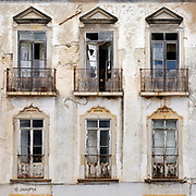 Balcony windows in a narrow street in Tavira, Algarve, Portugal