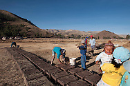 """Typical of the Andean world is the community work, the Minka, sometimes for the sake of the community, at other times to help a neighbor, people gather to perform work. In this case, in the village of XY along the Collasuyo, two families are making the bricks of """"adobe"""", the archaic system that consists of mixing straw and earth."""
