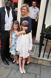 LADY HELEN TAYLOR and her daughters (l-r) ESTELLA TAYLOR (CHECK!) and ELOISE TAYLOR at a street party to celebrate HM The Queen Elizabeth 11 Diamond Jubilee held in Motcomb Street, London on 30th May 2012.