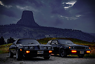 """BOLO Photo<br /> Wild West Automotive Photography<br /> """"Darkness Falling Fast""""<br /> August 18, 2018<br /> Devils Tower, Wyoming<br /> (1987 Buick Turbo T: Wayne Emmons)<br /> (1979 Pontiac Trans Am: Heather Wendelboe)"""