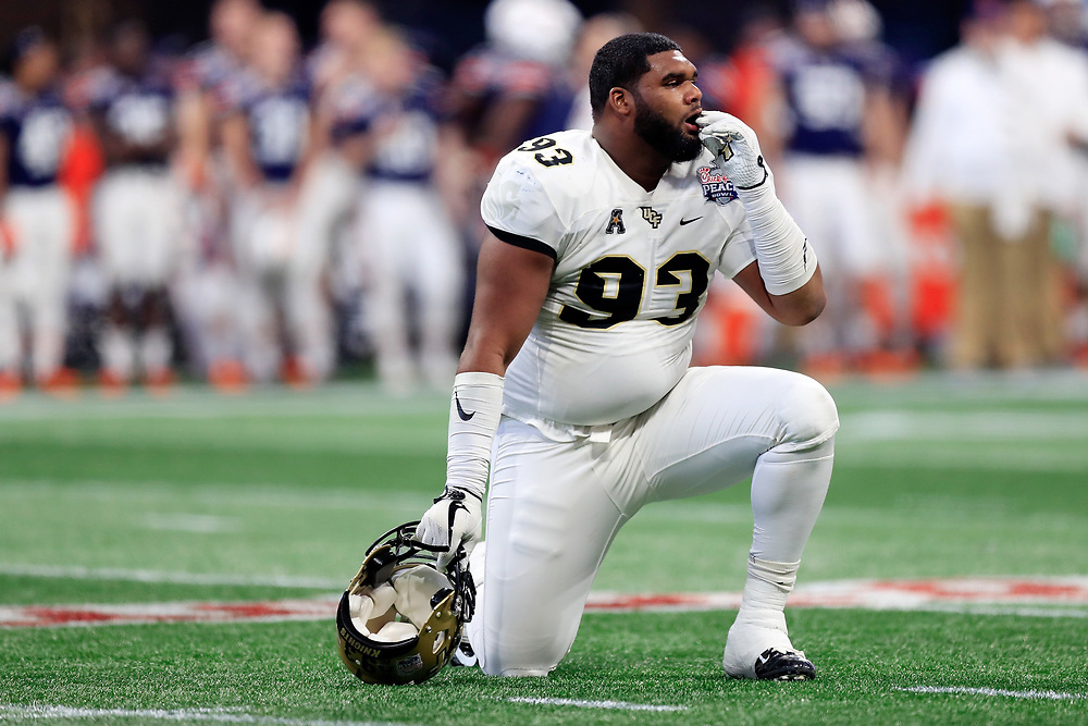 UCF Knights defensive lineman Tony Guerad (93) during the 2018 Chick-fil-A Peach Bowl NCAA football game against the Auburn Tigers on Monday, January 1, 2018 in Atlanta. (Paul Abell / Abell Images for the Chick-fil-A Peach Bowl)