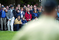 Photograph: Scott Heavey<br />Volvo PGA Championship At Wentworth Club. 25/05/2003.<br />Trevor Immelman watches on as Ignacio Garrido chips in during the play-off on the 18th green.