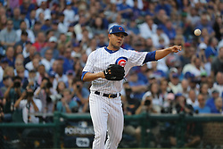 October 9, 2017 - Chicago, IL, USA - Chicago Cubs starting pitcher Jose Quintana (62) throws to first base to get Washington Nationals shortstop Trea Turner (7) out at the start of Game 3 of a National League Division Series playoff on Oct. 9, 2017 at Wrigley Field in Chicago. (Credit Image: © Christopher Sweda/TNS via ZUMA Wire)