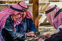 Men playing manqala (a game), As-Salt, Jordan.