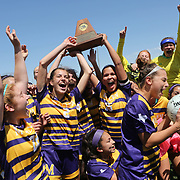McAllen High's Hannah Kelly, center left, and Jackelyn Lemus, center right, hold onto the Class 6A regional soccer trophy while celebrating with their team after defeating Austin Lake Travis 1-0 Saturday, April 14, 2018, at Blossom Athletic Center in San Antonio. photo by Nathan Lambrecht/The Monitor
