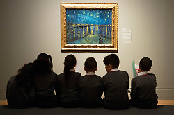 © Licensed to London News Pictures. 25/03/2019. School children from Milbank Primary Academy view a painting titled The Starry Night (1888) by artist Vincent van Gogh. The painting is part of The EY Exhibition: Van Gogh and Britain at the Tate BritainLondon, UK. Photo credit: Ray Tang/LNP