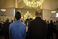 Sako, in blue  and Sarkis to his right, both Syrian-Armenians from Aleppo, celebrate Easter Sunday at the St Gregory Cathederal in Yerevan, Armenia. There are an estimated 6,500 Syrian-Armenians currently living in Armenia. Bradley Secker, Sunday 31st March 2013. Yerevan, Armenia.