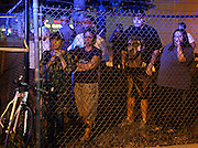 Neighbors watch as Chicago police investigate the scene where multiple people were shot at 2903 N Kilpatrick Ave on Friday, June 21, 2013. (Brian Cassella/Chicago Tribune)  B583014498Z.1 <br /> ....OUTSIDE TRIBUNE CO.- NO MAGS,  NO SALES, NO INTERNET, NO TV, CHICAGO OUT, NO DIGITAL MANIPULATION...