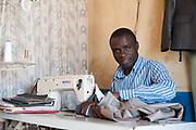Portrait of a clothing maker in Kibera