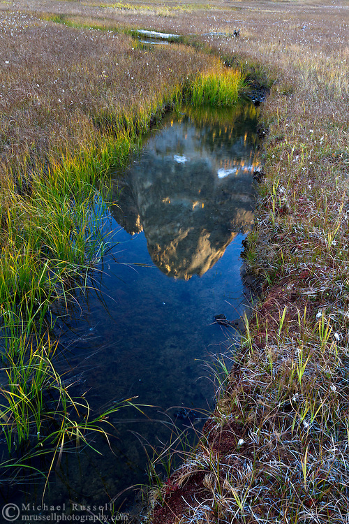 Liberty Bell Mountain is reflected in the small streams in the meadows at Washington Pass at sunset - in the North Cascades of the Okanogan-Wenatchee National Forest in Washington State, USA.