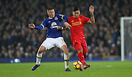 Ross Barkley of Everton and Roberto Firmino of Liverpool during  the English Premier League match at Goodison Park, Liverpool. Picture date: December 19th, 2016. Photo credit should read: Lynne Cameron/Sportimage