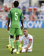 JACKSONVILLE, FL - JUNE 07:  Forward Clint Dempsey #8 of the United States reacts after being tripped by defender Eric Efe Ambrose #5 of Nigeria durng the international friendly match at EverBank Field on June 7, 2014 in Jacksonville, Florida.  (Photo by Mike Zarrilli/Getty Images)