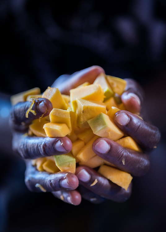 2 November 2019, Ganta, Liberia: a woman holds a handful of sliced pumpkin, to be made into food for patients at Ganta Hospital. Located in Nimba county, the Ganta United Methodist Hospital serves tens of thousands of patients each year. It is a founding member of the Christian Health Association of Liberia.