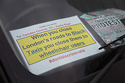 Licensed taxi drivers block the traffic in Parliament Square between 1pm-4pm in protest against traffic policies, 11th of February 2019, Central London, United Kingdom. A flyer in the window of a cab explaining the protest. The disgruntled taxi drivers feel squeezed by local government transport policies. They say they will continue their protest and blockade the square every other day the same time until they feel the Mayor of London listens to them.