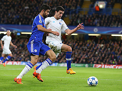 Diego Costa of Chelsea and Ivan Marcano of FC Porto challenge for the ball - Mandatory byline: Paul Terry/JMP - 09/12/2015 - Football - Stamford Bridge - London, England - Chelsea v FC Porto - Champions League - Group G