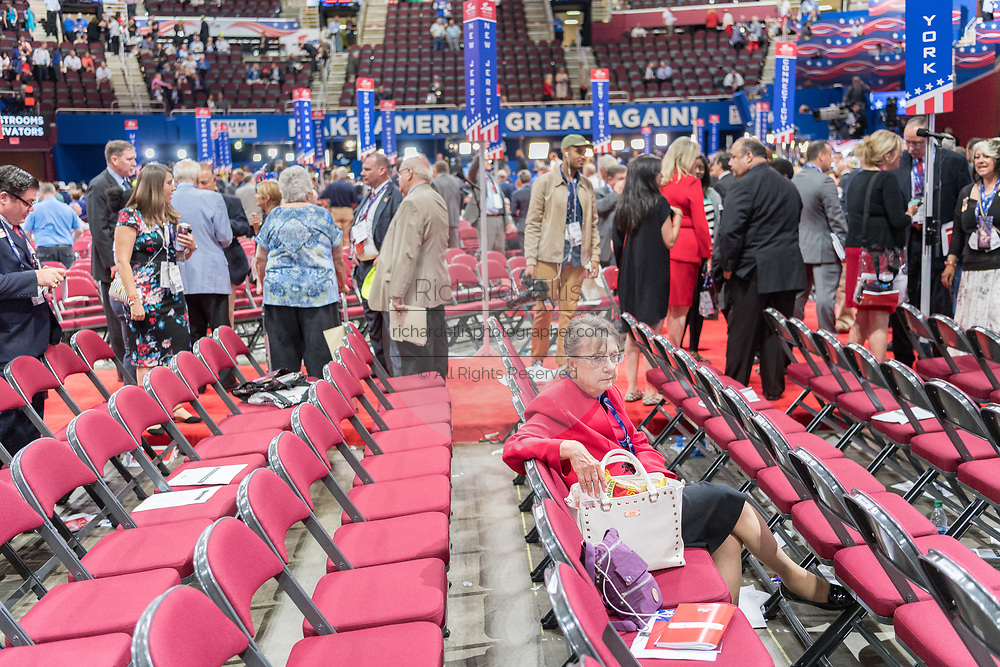 An elderly delegate sits alone in her seat as delegates gather for the first day of the Republican National Convention at the Quicken Loans Center July 18, 2016 in Cleveland, Ohio.